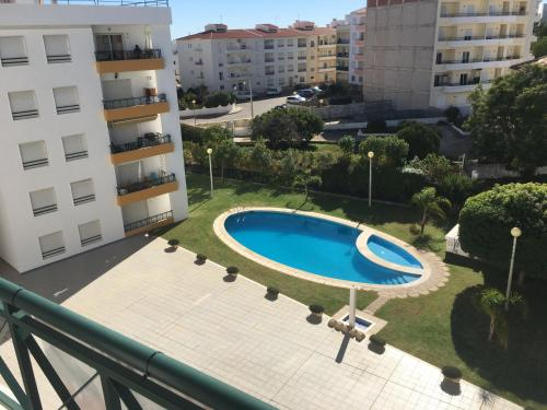 A view of the pool at Quiet apartment overlooking the swimming pool or nearby