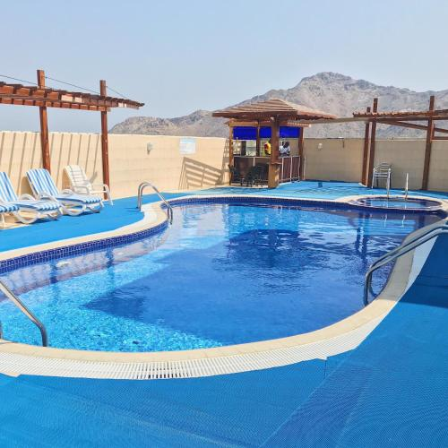 The swimming pool at or near Mirage Hotel Al Aqah