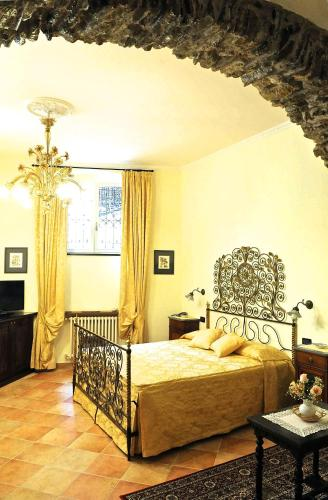 A bed or beds in a room at Il Giardino Incantato