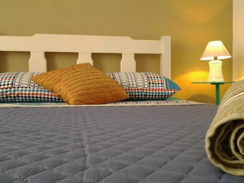Cama o camas de una habitación en Apart lindo e bem localizado