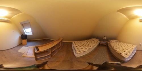 A bed or beds in a room at Virág-Apartman