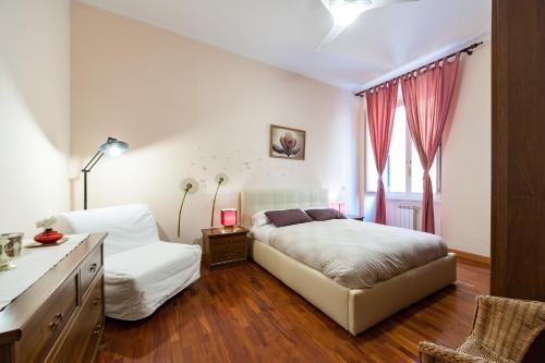Un ou plusieurs lits dans un hébergement de l'établissement TriDomus Apartment - Mecenate 77