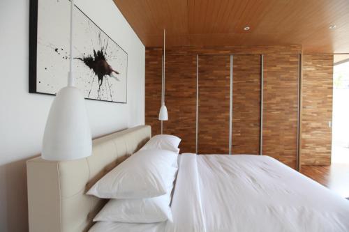 Un ou plusieurs lits dans un hébergement de l'établissement One Eleven