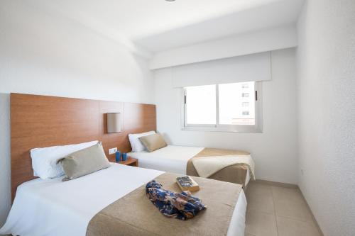 A bed or beds in a room at Pierre & Vacances Benidorm Levante