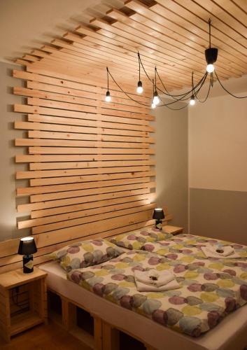 A bed or beds in a room at Guest House Park Žibert
