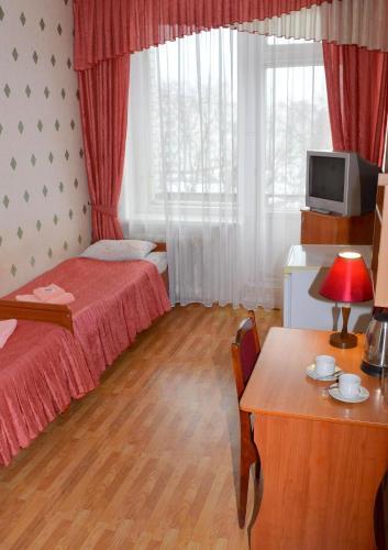 Телевизор и/или развлекательный центр в Гостиница Веда