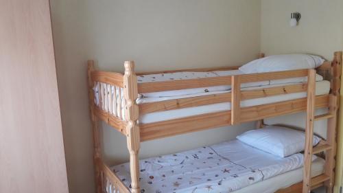 A bunk bed or bunk beds in a room at de Zandput 46
