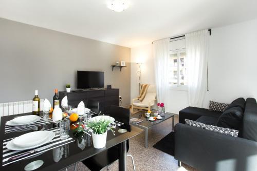 A seating area at Apartamento Roger de Lluria