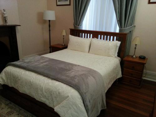 A bed or beds in a room at Burra Railway Station Bed and Breakfast