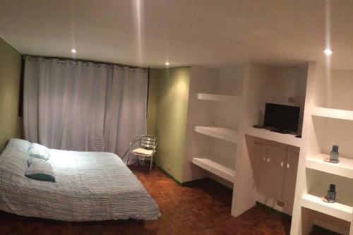 Cama o camas de una habitación en Beautiful Apartment San Jose Downtown 3