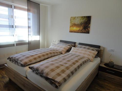 Ein Bett oder Betten in einem Zimmer der Unterkunft Gasthof Reiterstuben