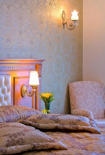 Lova arba lovos apgyvendinimo įstaigoje Acra Hotel - Special Category