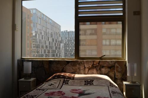 Cama o camas de una habitación en Parque Arauco Departamento Estudio Las Condes