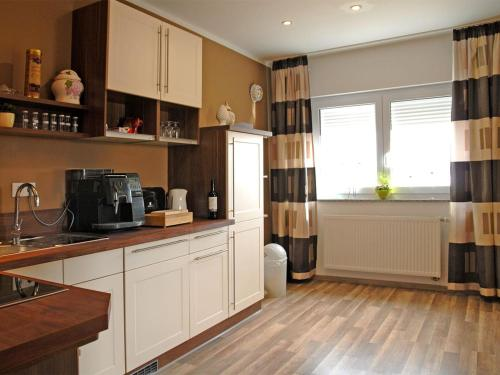 A kitchen or kitchenette at NM-APARTMENTS