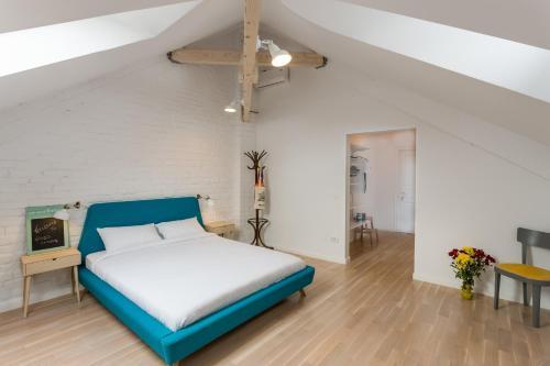 מיטה או מיטות בחדר ב-Good Living Bucharest