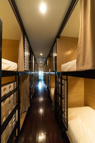 A bunk bed or bunk beds in a room at H2B Hostel