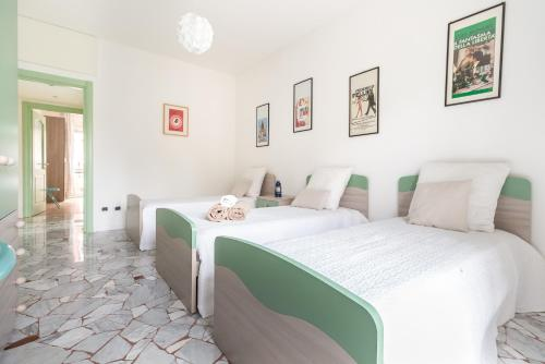A bed or beds in a room at Alessia's Flat- Lotto M5/M1