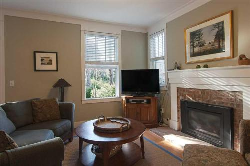A television and/or entertainment center at Coyote Cottage Four-Bedroom Home