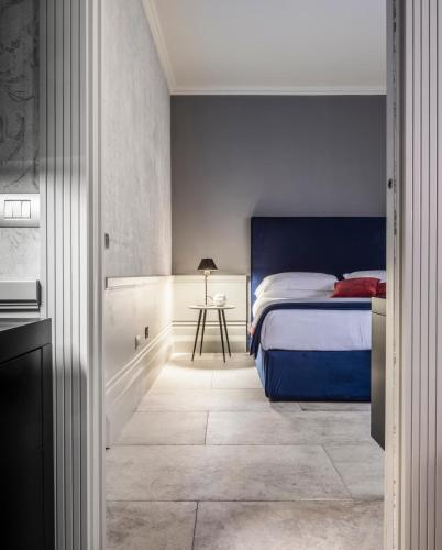 A bed or beds in a room at Fifty House Soho