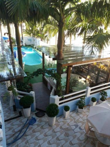 The swimming pool at or near Pousada Bella Praia