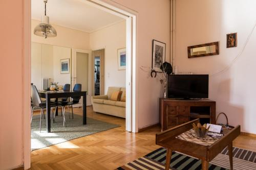 A television and/or entertainment center at Two-Bedroom Apartment -Kallirrois Athens