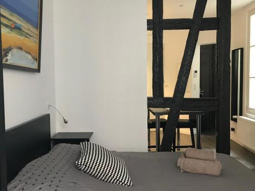 A bed or beds in a room at Appartement L'Ill au Sable