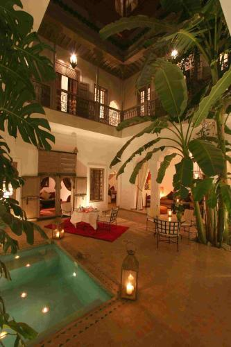 The swimming pool at or near Riad Altair