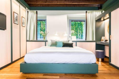 A bed or beds in a room at ALTIDO 9 Montenapo