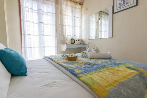 A bed or beds in a room at Stathopoulos Apartments