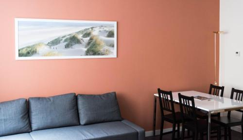 A seating area at City Center Apartments Grand Place