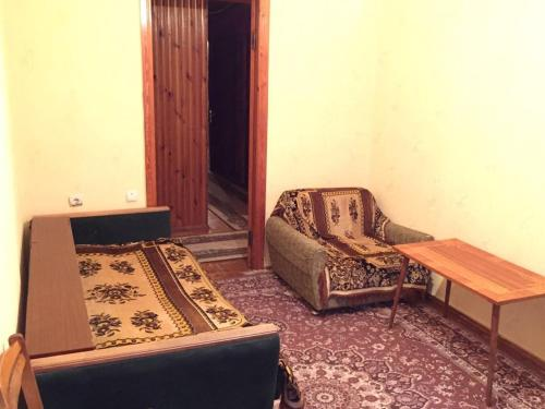 A bed or beds in a room at квартира под ключ
