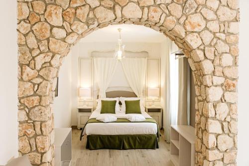 Cama o camas de una habitación en Suites La Posada De Pilar