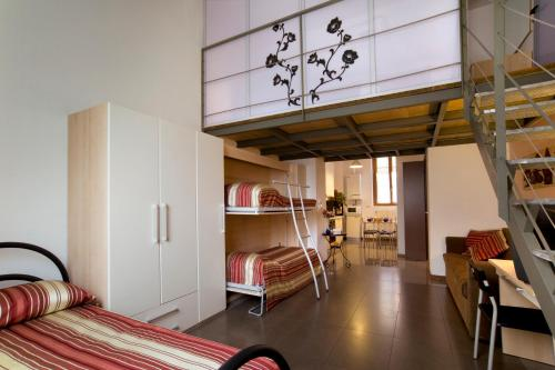 A bunk bed or bunk beds in a room at City Residence Milano