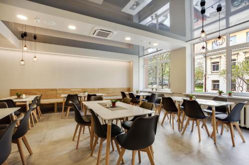 Restoranas ar kita vieta pavalgyti apgyvendinimo įstaigoje Old Town Trio Apartments