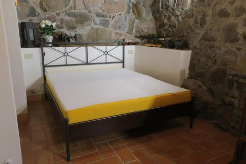 Un ou plusieurs lits dans un hébergement de l'établissement Casa Magrini