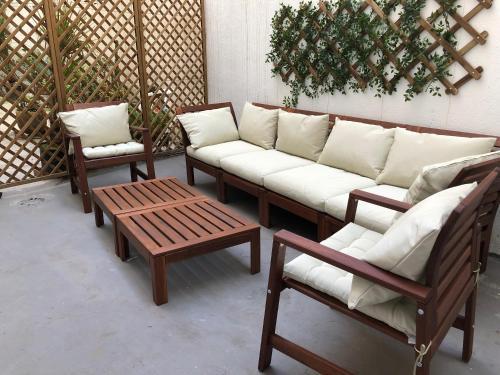 Ein Sitzbereich in der Unterkunft Central apartment with private patio