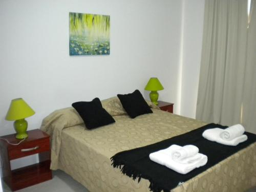 A bed or beds in a room at Kosten al Mar
