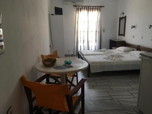 A bed or beds in a room at Poseidonio of Paros