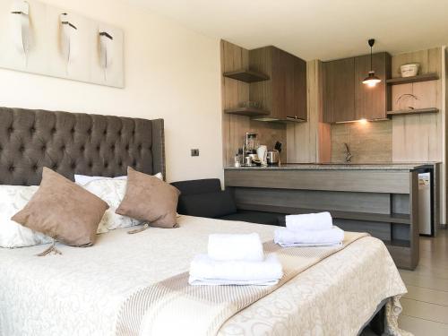 Cama o camas de una habitación en Majestic Studio Las Condes