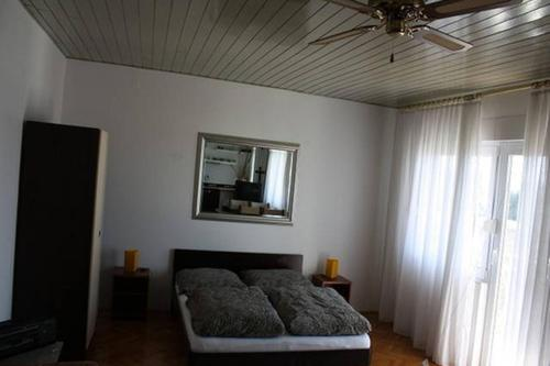 A bed or beds in a room at Villa Milic***