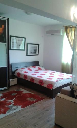 Un pat sau paturi într-o cameră la Apartment Neptun