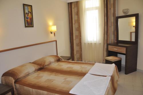 Lova arba lovos apgyvendinimo įstaigoje Primera Hotel & Apart