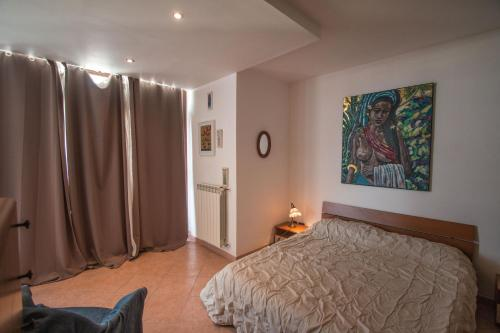 A bed or beds in a room at Casa Tiziana