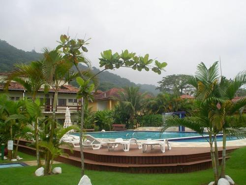 The swimming pool at or near Flat Maresias