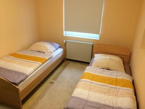 Ein Bett oder Betten in einem Zimmer der Unterkunft Elbe Ferienwohnung