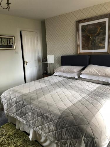 A bed or beds in a room at Pitreavie Guest House