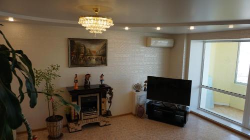 Телевизор и/или развлекательный центр в апартаменты на набережной