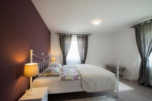 Postelja oz. postelje v sobi nastanitve Apartma Bled