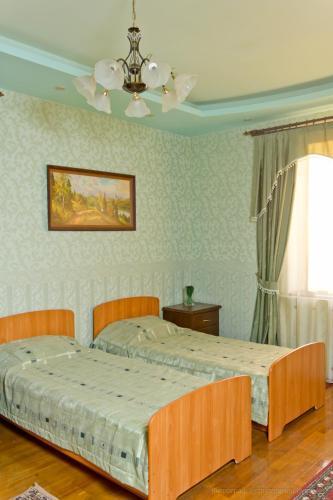 Кровать или кровати в номере Хостел у Аквапарка и клиники Мать и Дитя