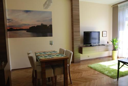 A television and/or entertainment center at Excellent apartment with balcony